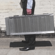 Buying a wheelchair ramp at Sync Living: Enable Access suitcase ramp